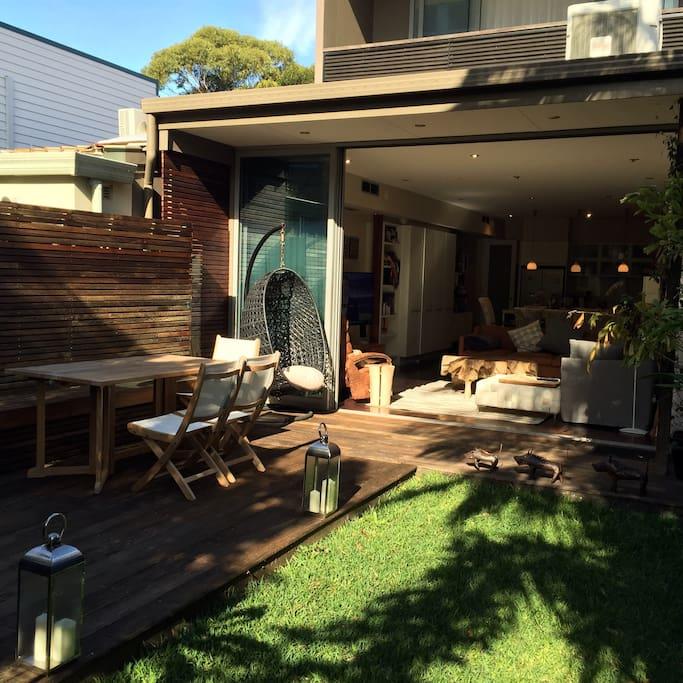 Sunlit garden - half deck, half grass