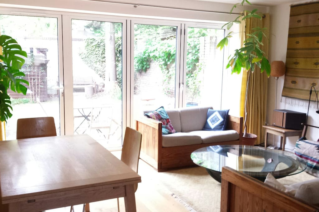 The spacious open plan living and dining room, leading to patio and garden.