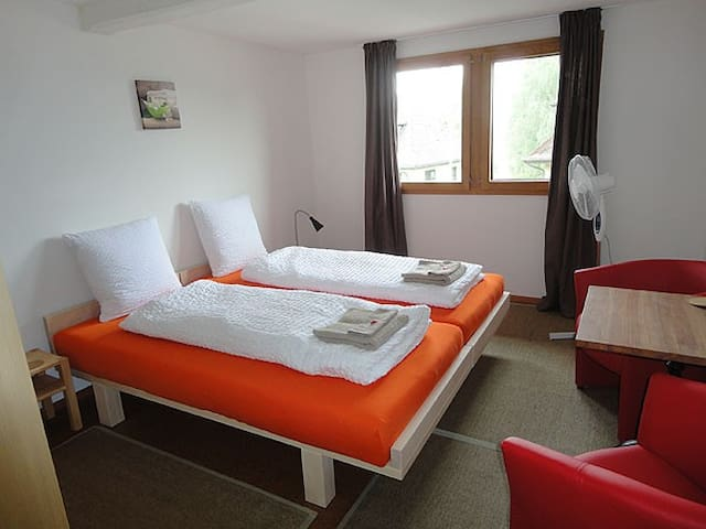 Bright double room on second floor. Solid wooden bed 180x200cm.
