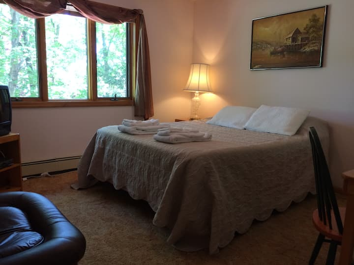 Queen bedroom in a B&B, shared bath