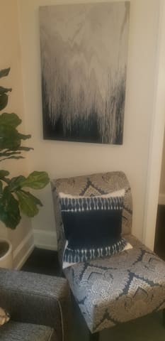 Living room chair - decor is navy blue, gray and white.