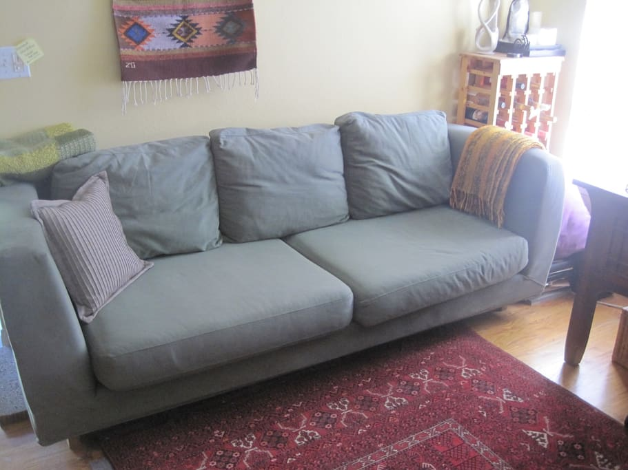 You would sleep on a new, larger (longer and wider) pull out sofa instead of the one shown in this photo. Single guest sleeps couch style, two on a pull out sofa.