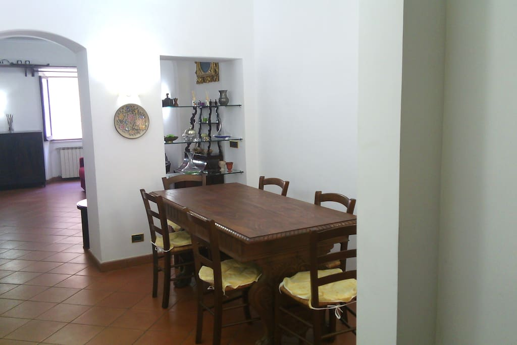 Dining room with big wooden table and six chairs (more chairs are available in the house).