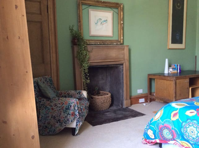 Original fireplace, desk,wardrobe and armchair