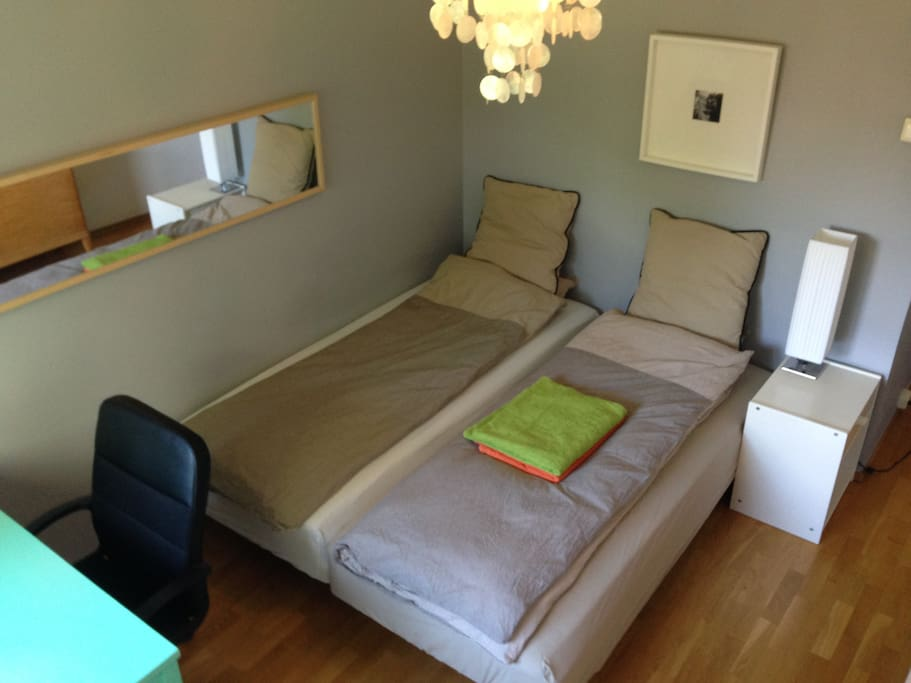 Bedrom for two people with workspace overlooking quiet recreation area.