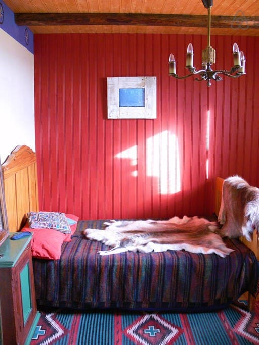 The guestroom, downstairs, with views out onto the fjord