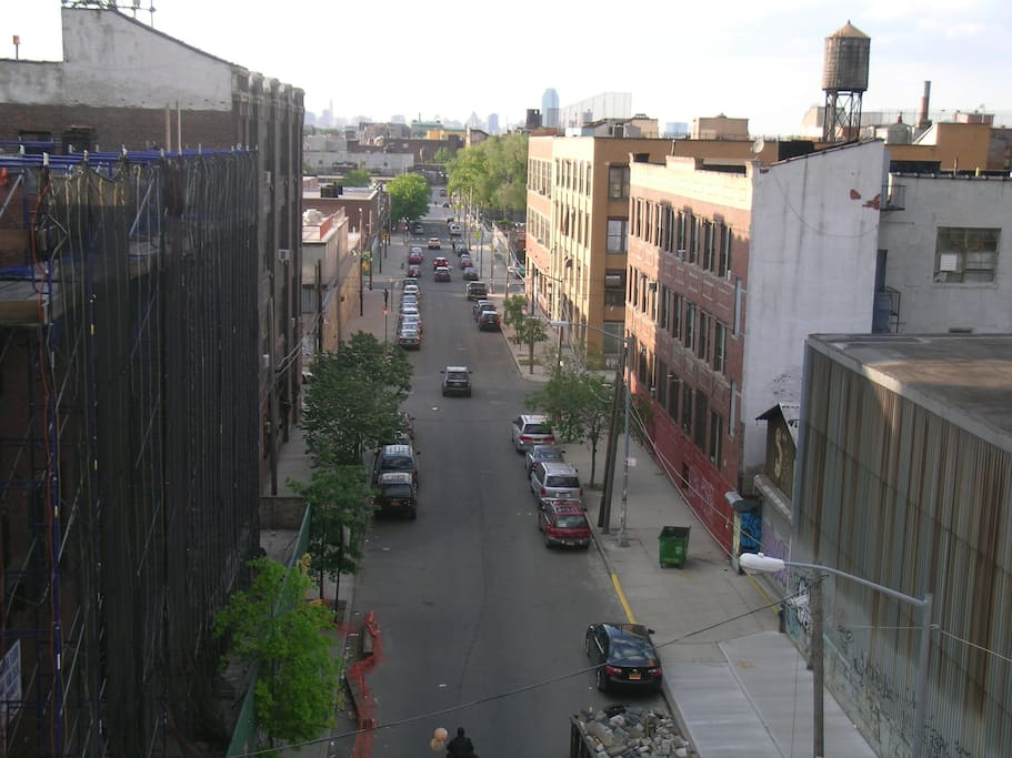 We have a great view of typical Bushwick. You'll be less than 5 minutes from two train stations running into Manhattan.