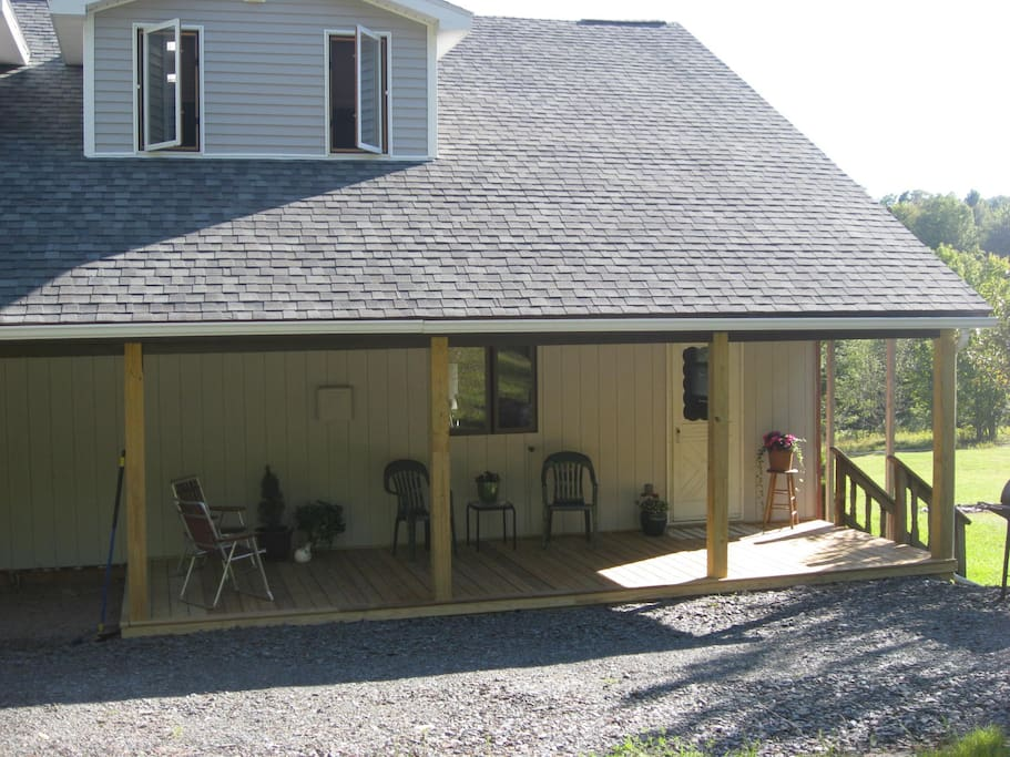 This is the back porch and entrance into the mud room.  Nice seating area while grilling or for just enjoying the view of woods out back..