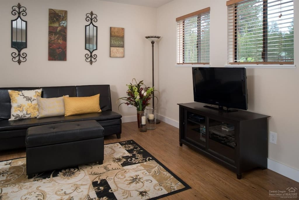 Futon can be used for additional bed. Entertainment center with Large flat screen TV, Cable, portable stereo and DVD player.