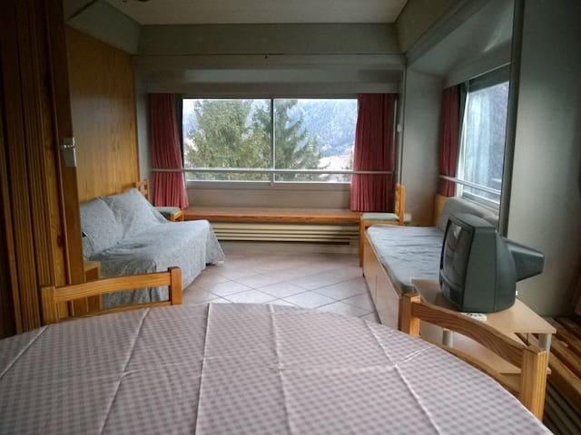Flat on ski slopes with panorama