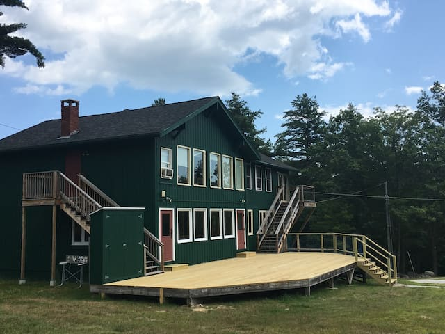 A large deck and a very spacious front lawn await you!
