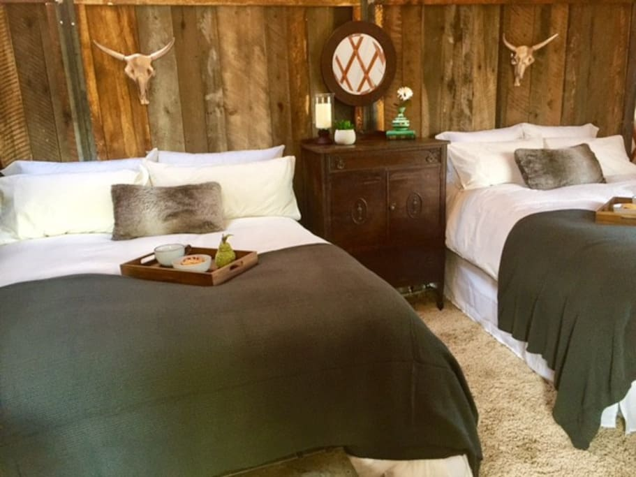 Our cozy yurt bedroom with two queen beds and sitting area