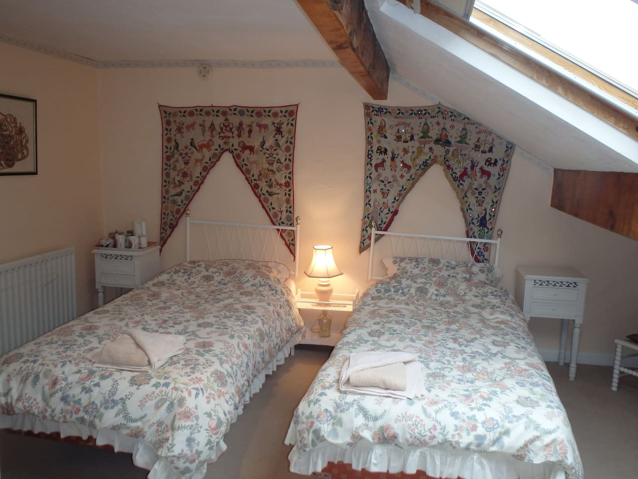 Comfortable twin room with ensuite shower, wc and sink
