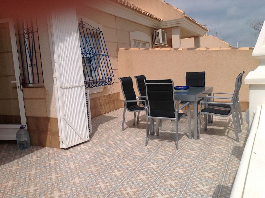 Front terrace with extending glass table