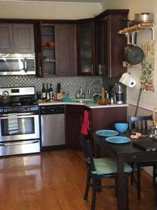 Kitchen with full size refridgerator, dishwasher and fully equipped with dishes, pots, pans, cups, utensils, etc..