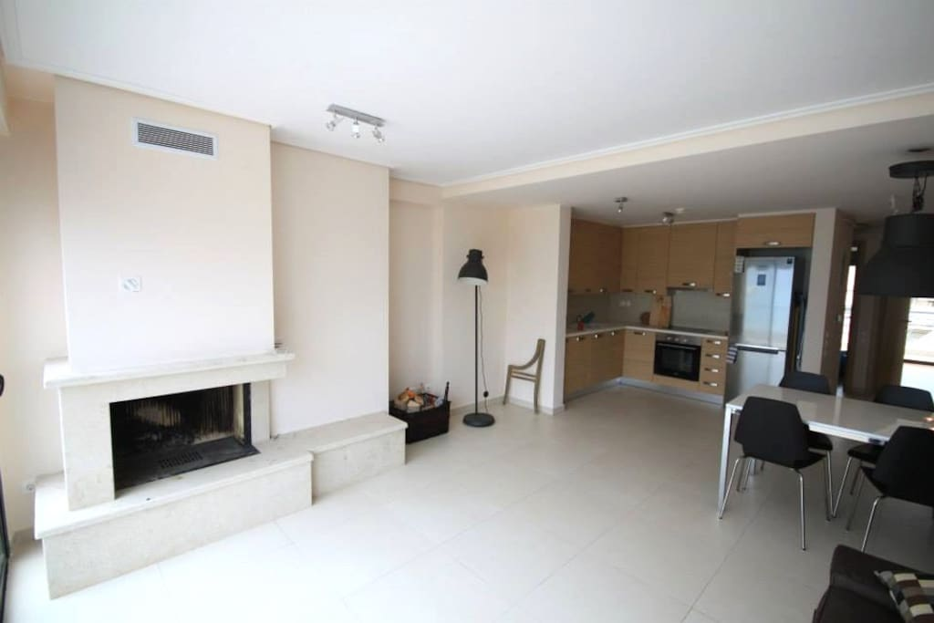 Living room with kitchen. Including flat TV, dishwasher  and washing machine.