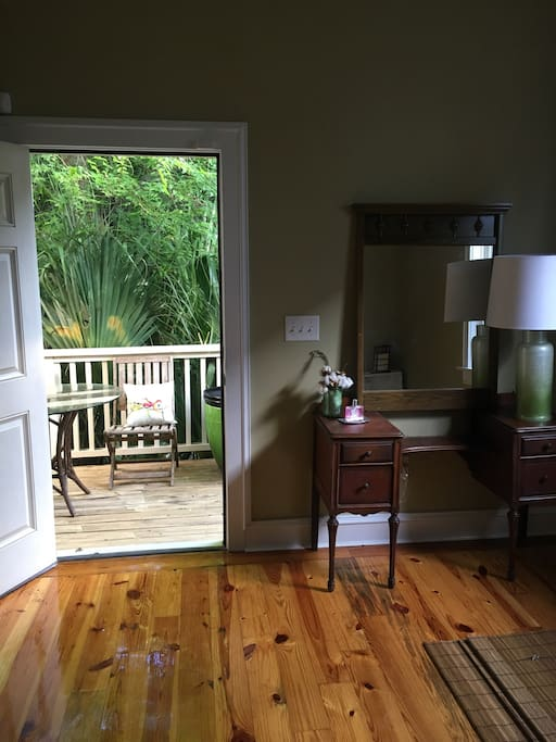 Lovely little porch off the master bedroom with table and chairs for morning cup of coffee.