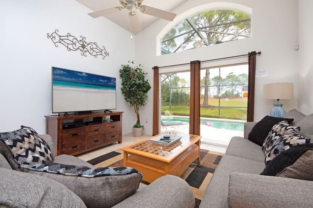 Main living room overlooks the pool. Great place to watch a game or relax after a day in the parks.
