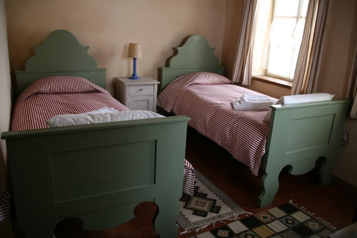 Twin bedroom, private bathroom with bath tub