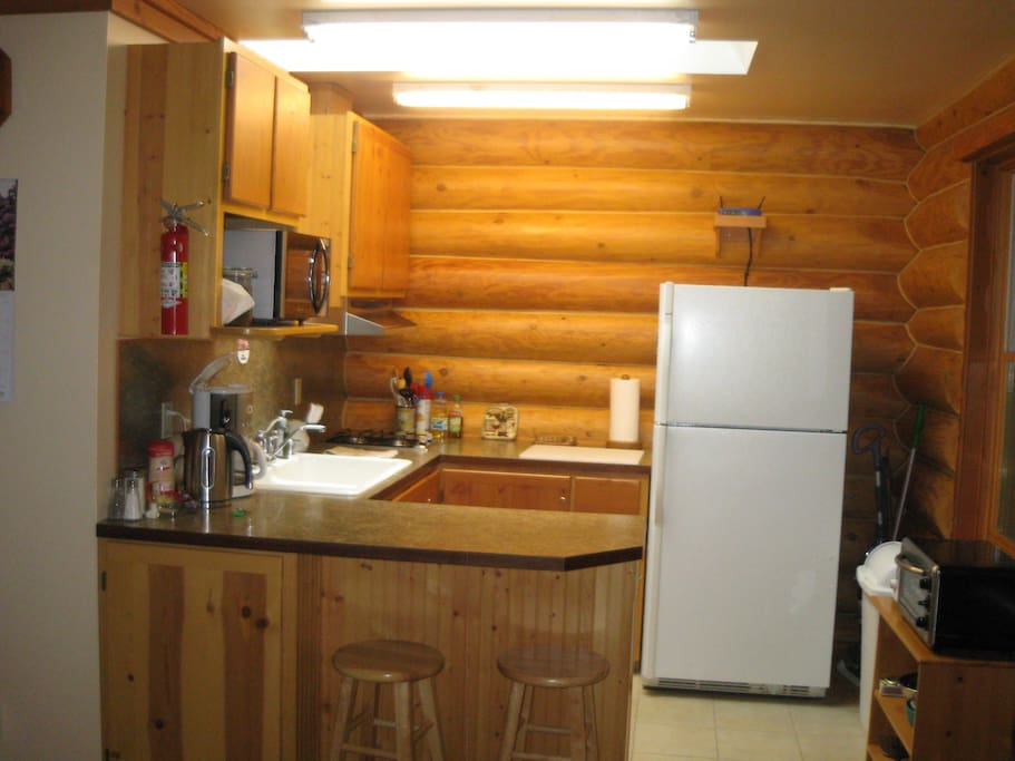 Kitchen with microwave, toaster, toaster oven, coffee and tea, skylite