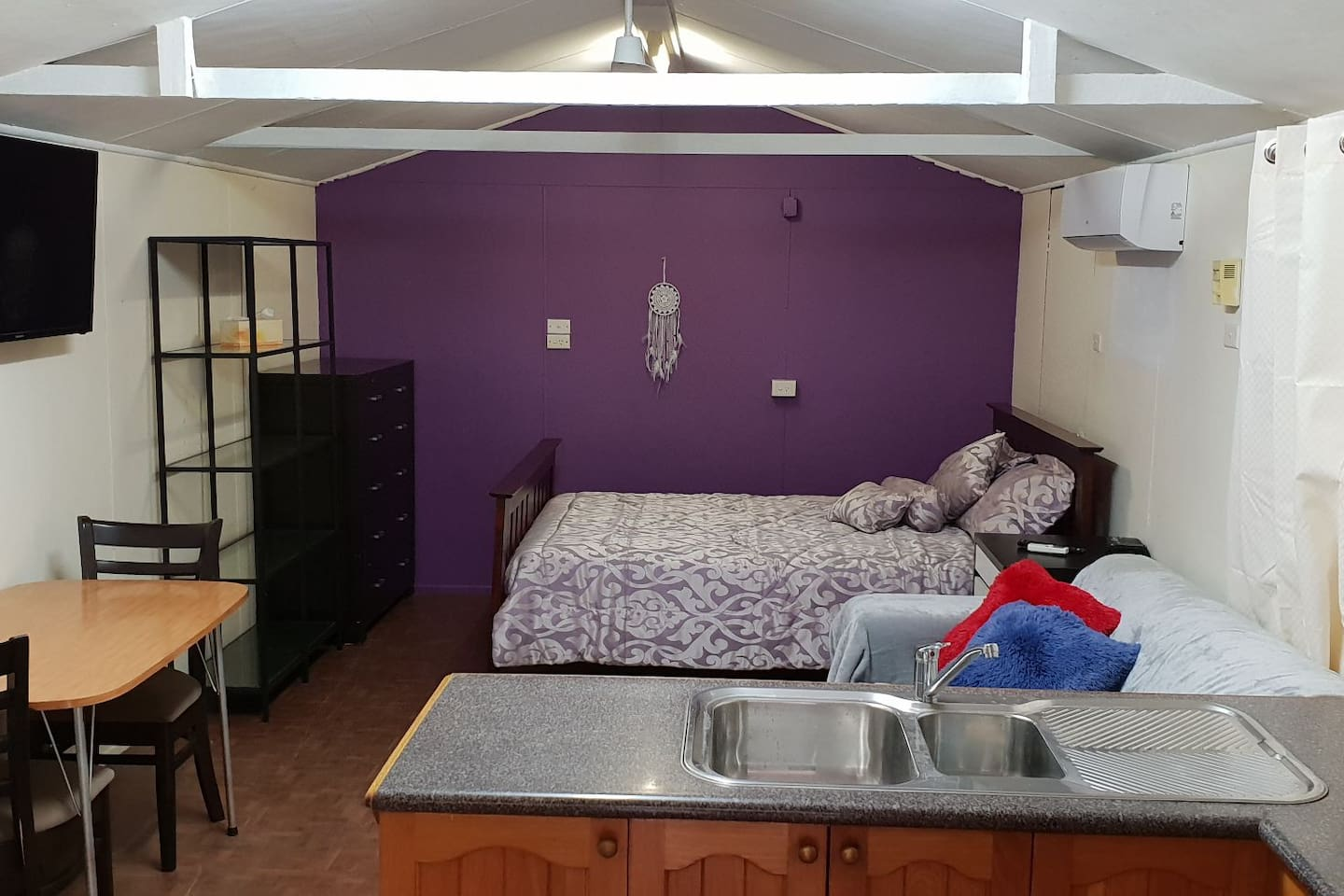 Granny Flat - bed, shelving and draws, sofa, mounted TV, has ceiling fan and air conditioning