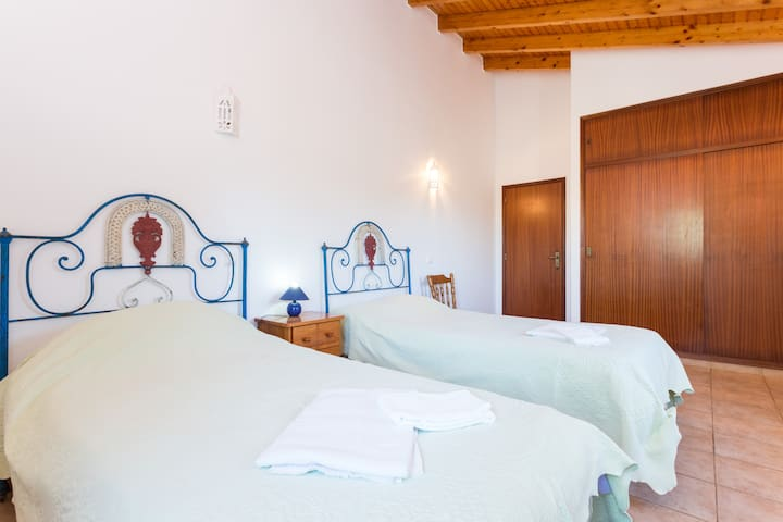 Bedroom 3 with twin beds & country views.