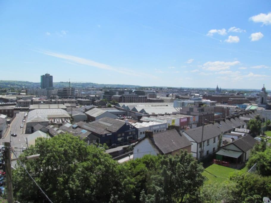 Views across the City to the west overlooking major land marks - (left to right, The Elysian (tallest building in the Republic), St Finbarrs Cathedral (tall spire), and County Hall)