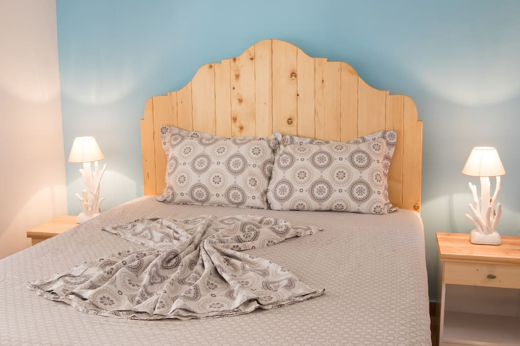 The orthopedic double mattress in private bedroom with a door.