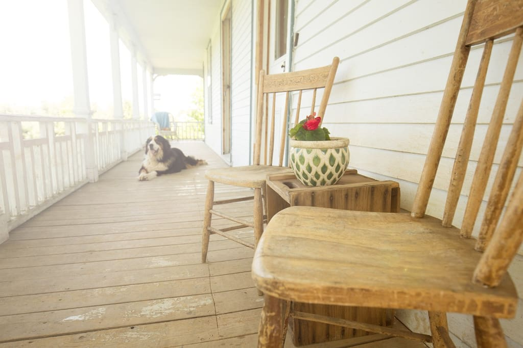 Watch the sunset on  the farmhouse veranda.