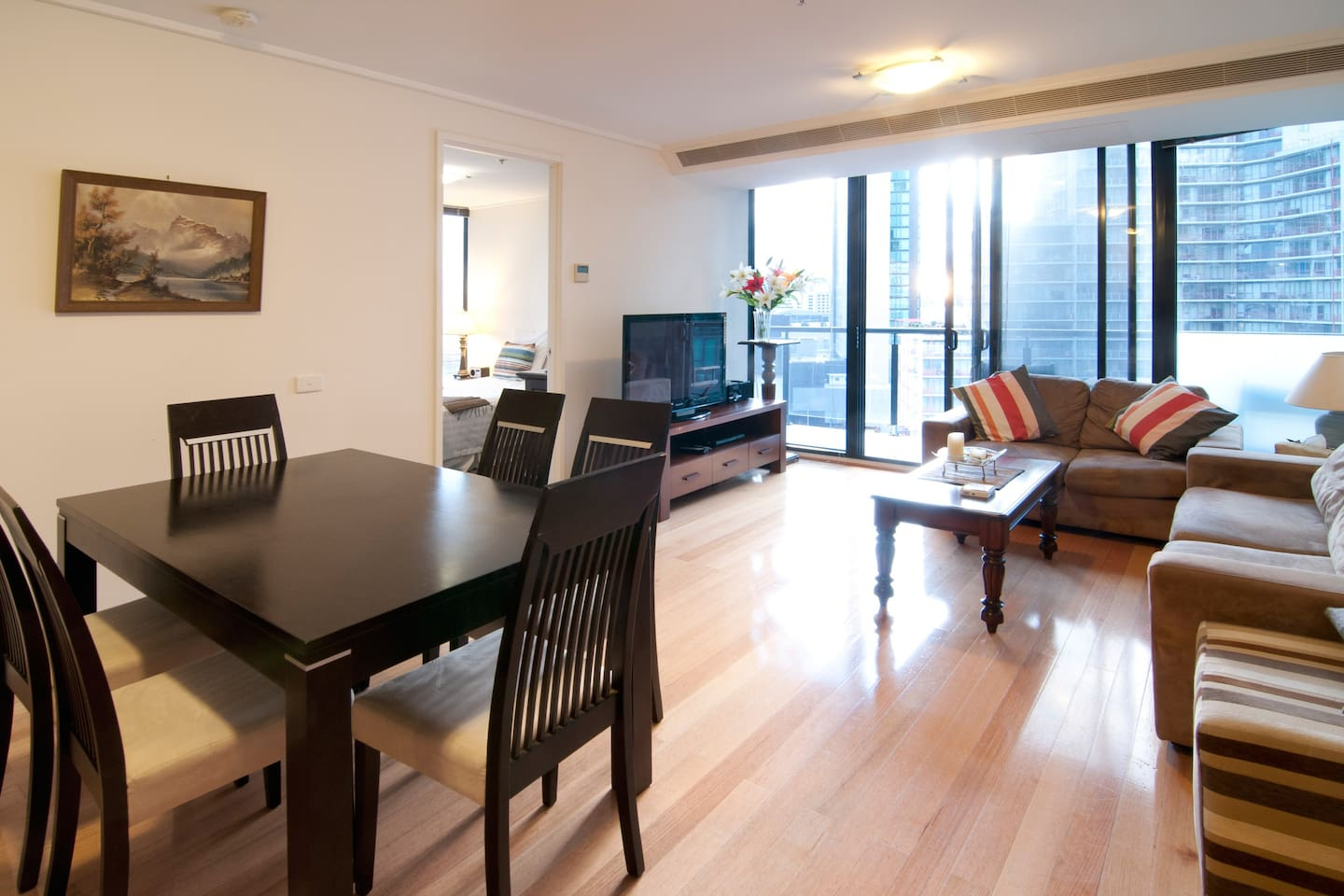 Spacious living room with 6 seater dining set