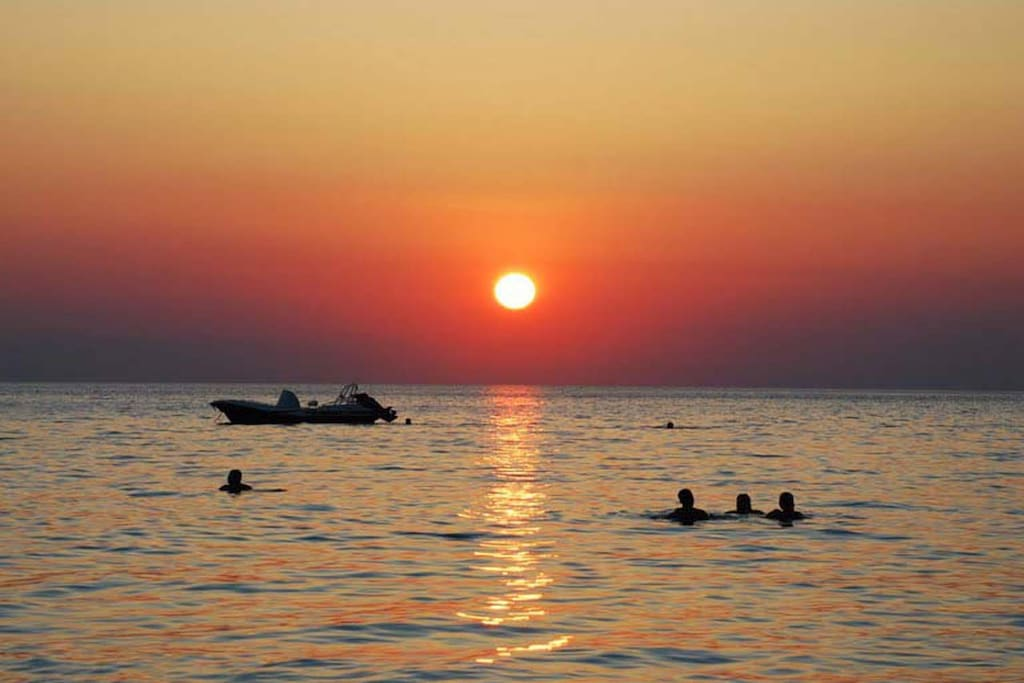 Swim in the clear sea with the sunset