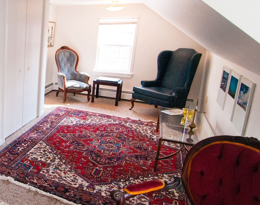 Living/Dining Room  with antique Iranian Rug and Contemporary Canadian Art.