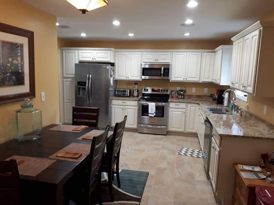 Eat in kitchen. Additional seating in sunroom.