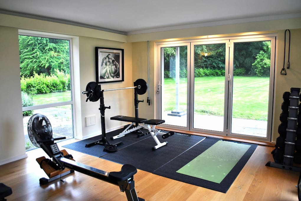 Gym with bi-fold doors that open fully onto the garden. Free weights, rowing machines, yoga mat and swiss ball, skipping rope, pull up board. Also got a flatscreen TV and DVD player in there.