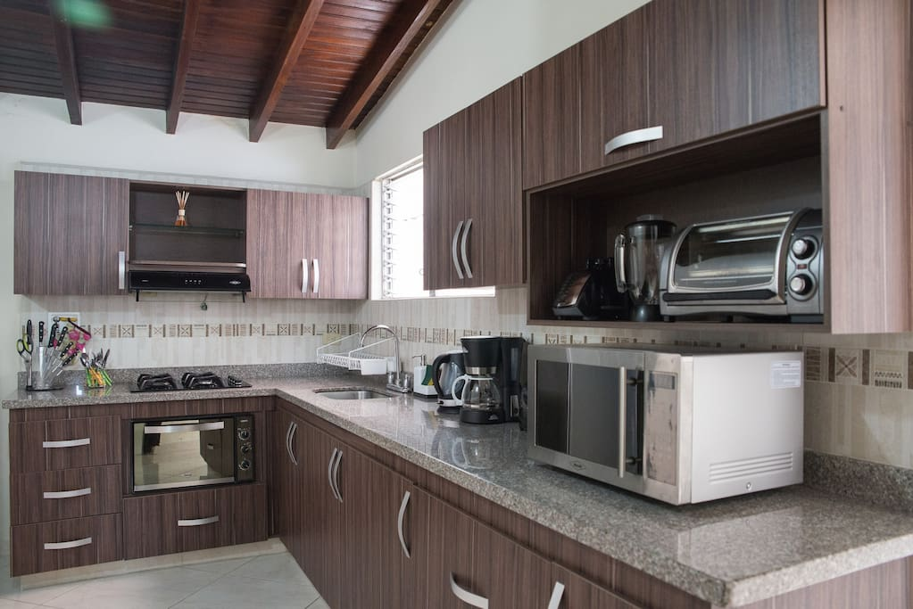 Spacious, fully equipped kitchen with new appliances.