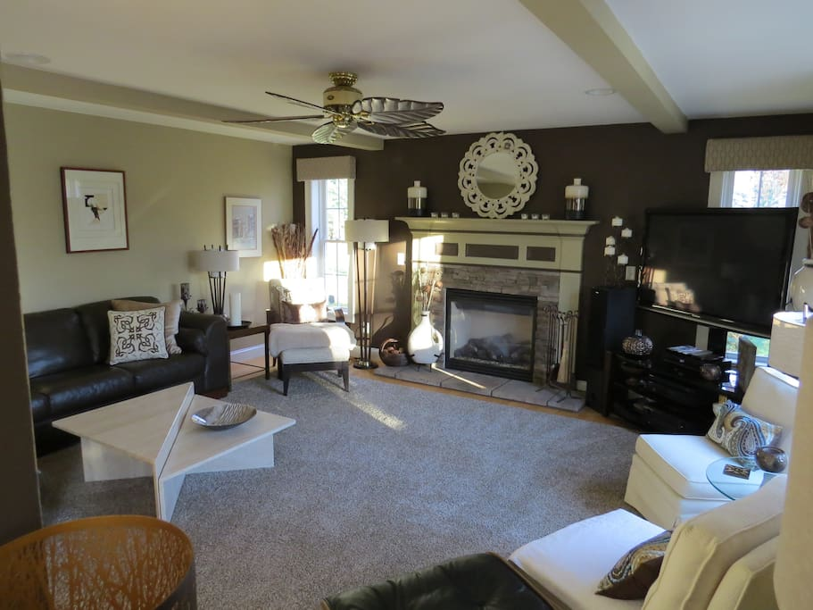 Family Room with plenty of seating and  70 inch flat screen TV