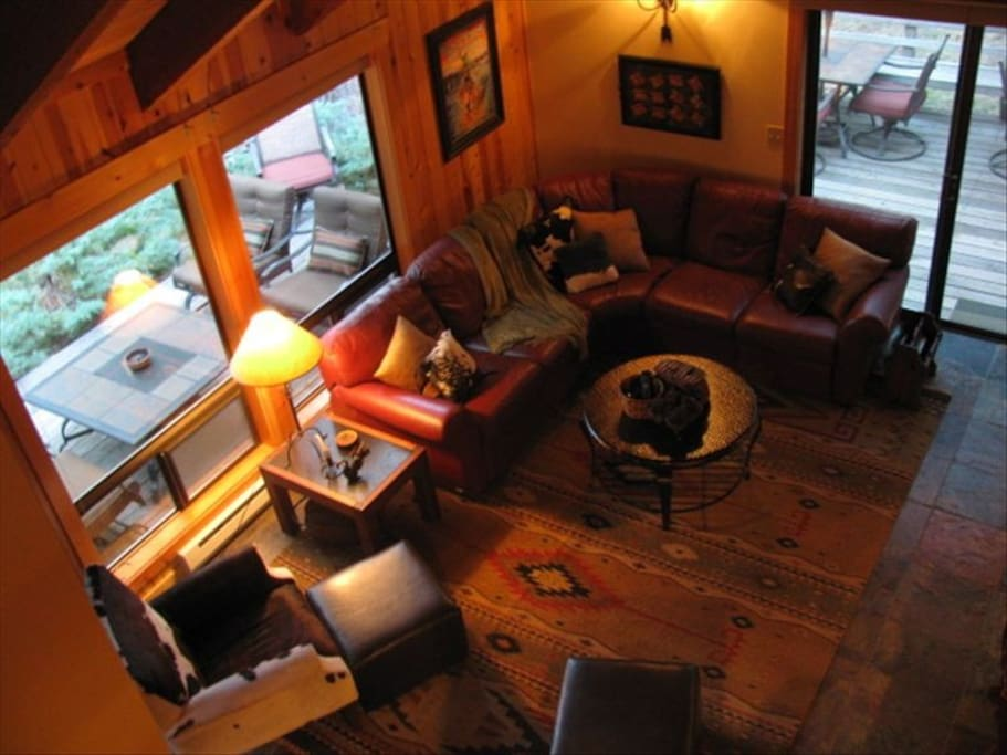 Arial View of living room featuring quality leather furniture, antiques and vintage Indian rug
