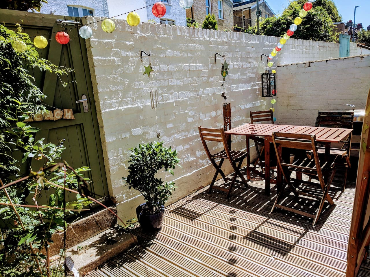 Generous sized deck with table, chairs and BBQ facilities including fire pit. Perfect for sunny afternoons and warm evenings.