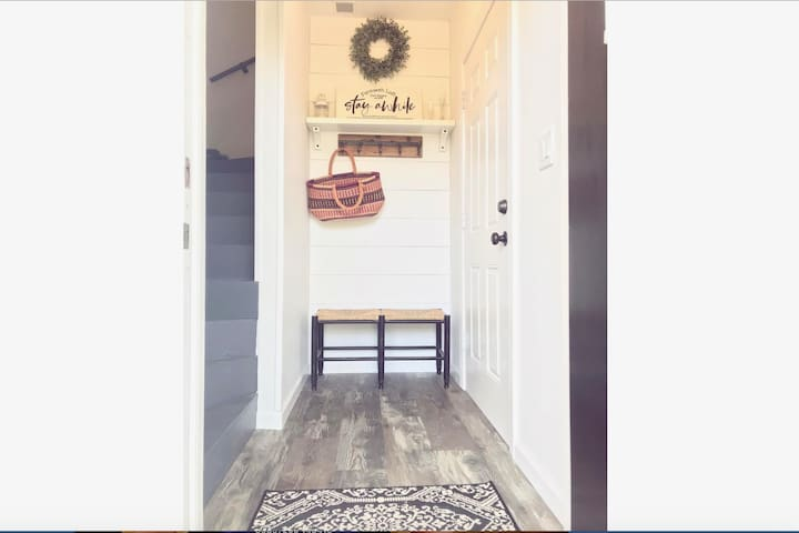 Welcoming entryway/mudroom ready for you to hang your beach gear!