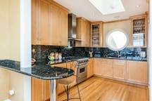 Large, well equipped kitchen: Viking stove, sub-zero frig., Miele appliances.