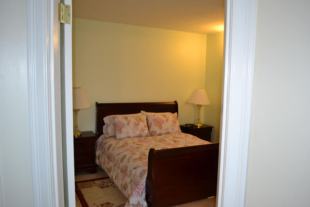 Queen size bed with private bath
