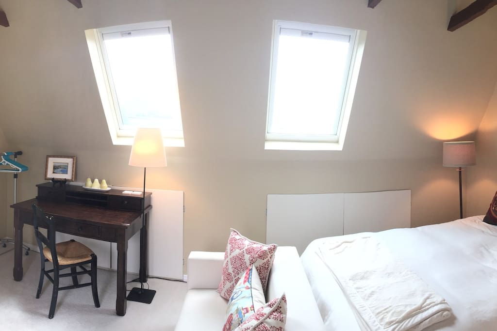 Pano View of room, Velux windows with solar powered shades