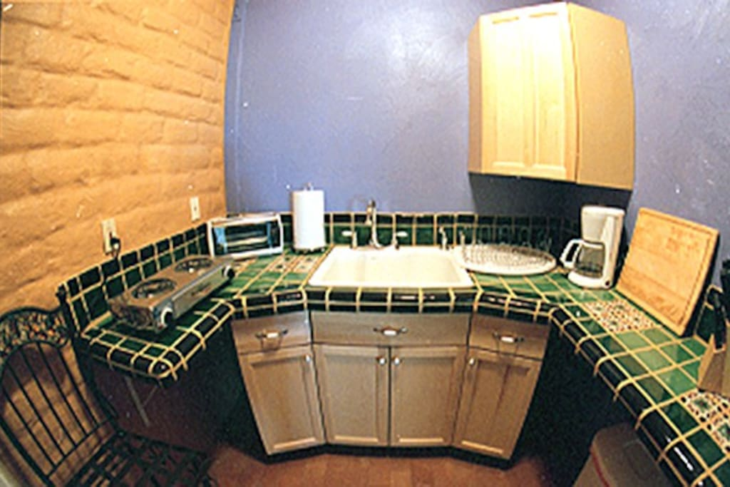 Cute Mexican tiled kitchen with amenities.