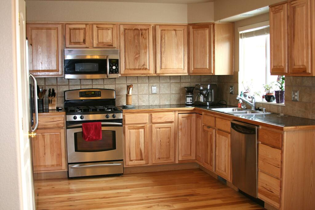 Fully stocked kitchen. Gas range, hickory cabinets and flooring. Stainless appliances.