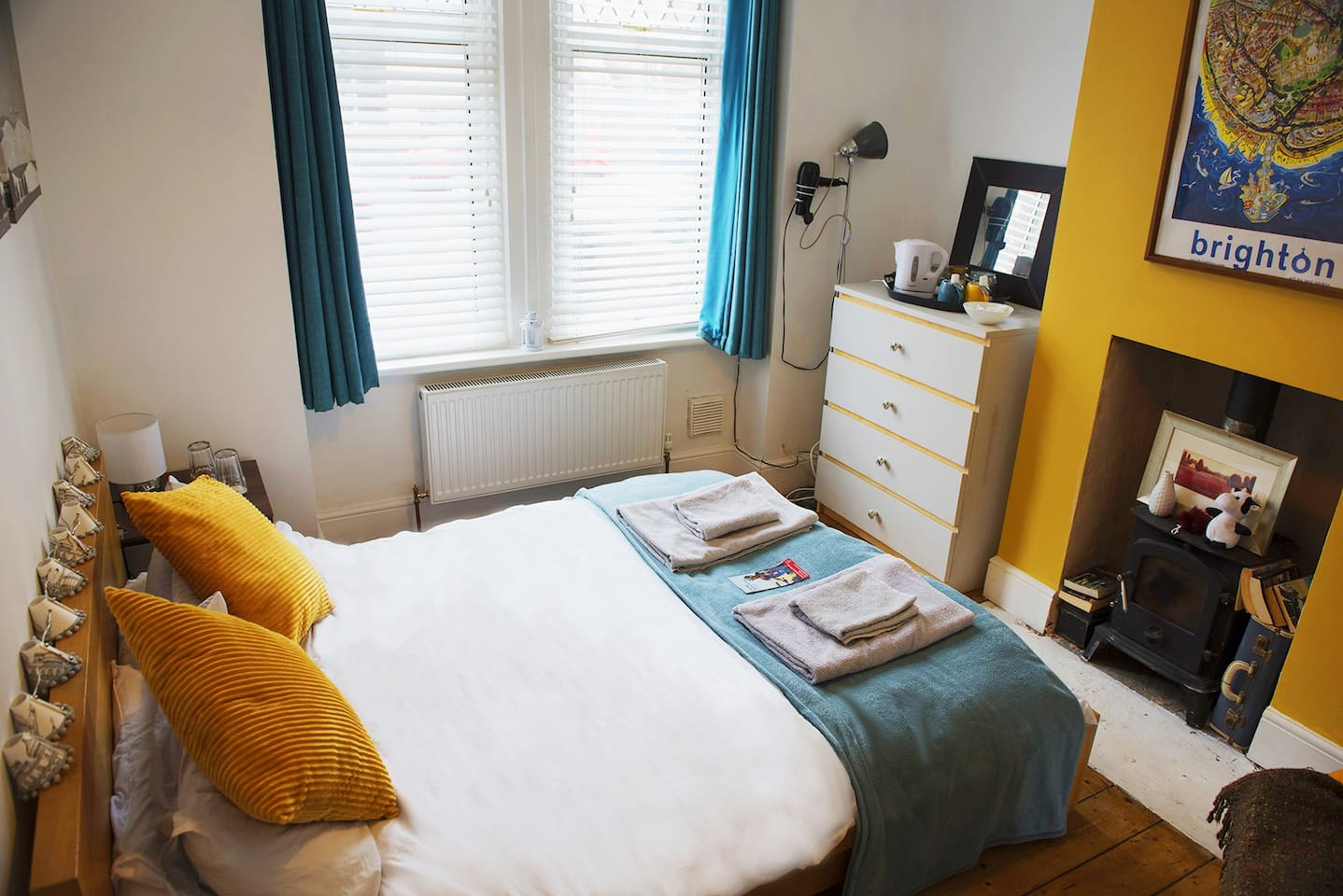 Your room with towels, storage, hair dryer, iron, kettle & shower gel