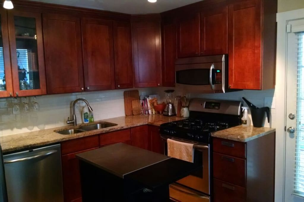 Kitchen has a gas range, microwave, dishwasher, fridge, center island, and more available for your use. Pull up a barstool and chat while making dinner.