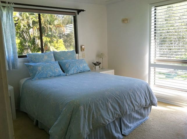 Wake up to a view of the river! Private bedroom with Queen Bed