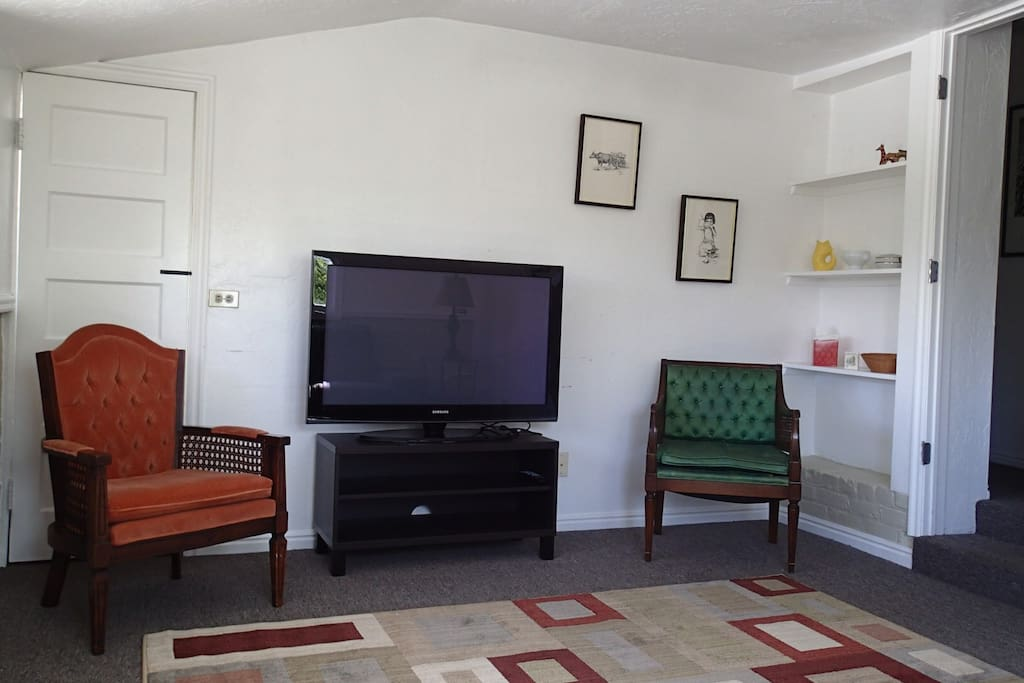 Living room with TV and DVD player.