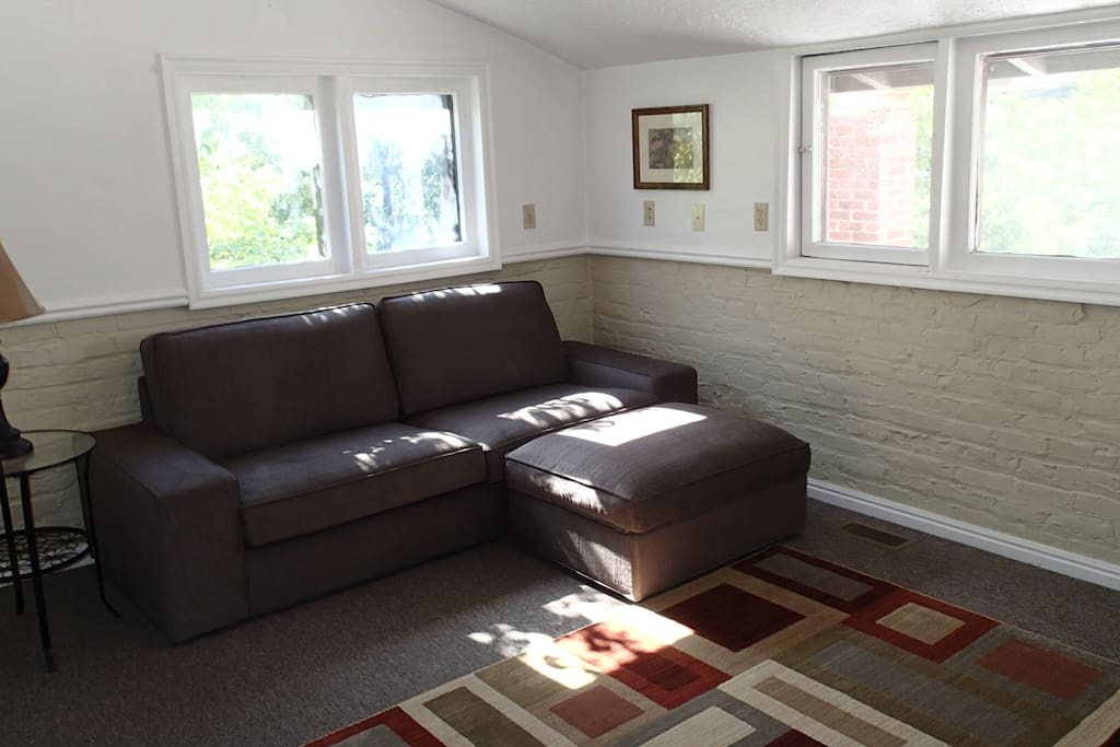 Living room with lots of natural light and overlooking Federal Ave/Church St. District.
