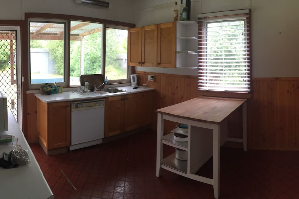 Cosy kitchen with dishwasher, oven, fridge, stovetop